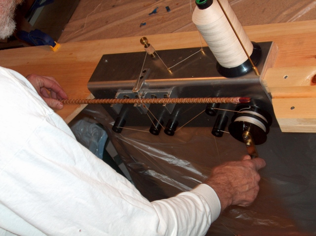 - The planed and hollowed bamboo strips are then glued together using Unibond 800 adhesive and a Bellinger Binder. The thread holds the strips together under a constant tension until the glue cures.