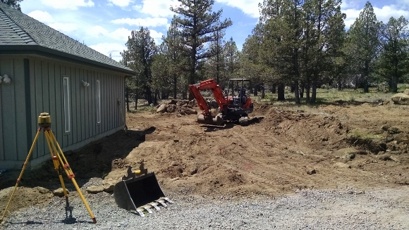 Trees are gone and dirt/rocks are being removed to make way for the foundation.