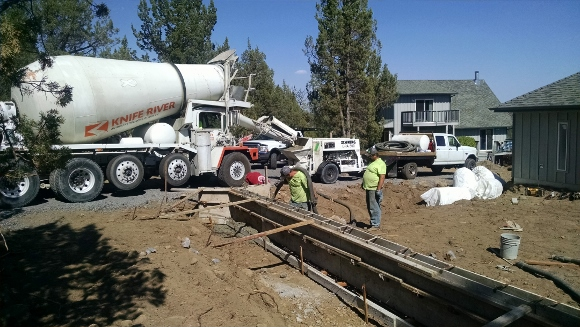 Constructing the concrete retaining wall.